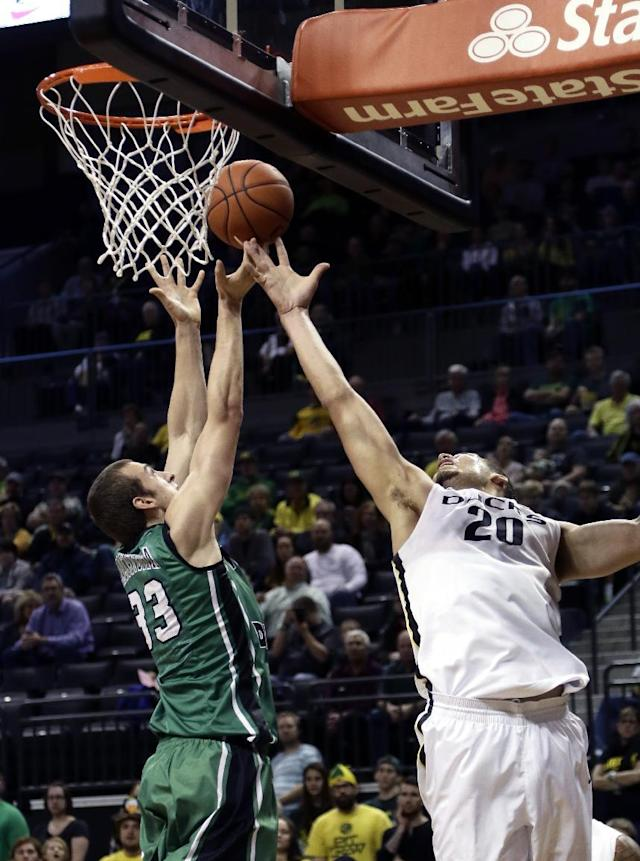 North Dakota forward Chad Calcaterra, left, battles for a rebound with Oregon center Waverly Austin during the first half of an NCAA college basketball game in Eugene, Ore., Saturday, Nov. 30, 2013. (AP Photo/Don Ryan)