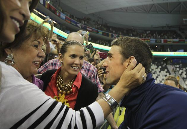 SHANGHAI, CHINA - JULY 29:  Michael Phelps of the United States shares a joke with mother Debbie and sister Hilary after the Men's 4x200m Freestyle during Day Fourteen of the 14th FINA World Championships at the Oriental Sports Center on July 29, 2011 in Shanghai, China.  (Photo by Ezra Shaw/Getty Images)