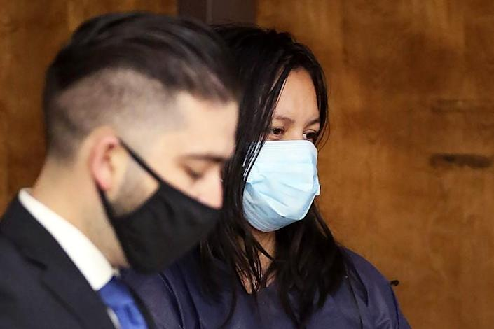 Deputy Public Defender Brandon Mata with Liliana Carrillo during her arraignment in Kern County Superior Court on Wednesday.