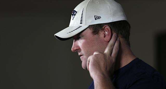New England Patriots guard Logan Mankins listens to a reporter's question during a football news conference at Gillette Stadium in Foxborough, Mass., Wednesday, July 23, 2014. Players reported to training camp with their first team practice scheduled for Thursday July 24th. (AP Photo)