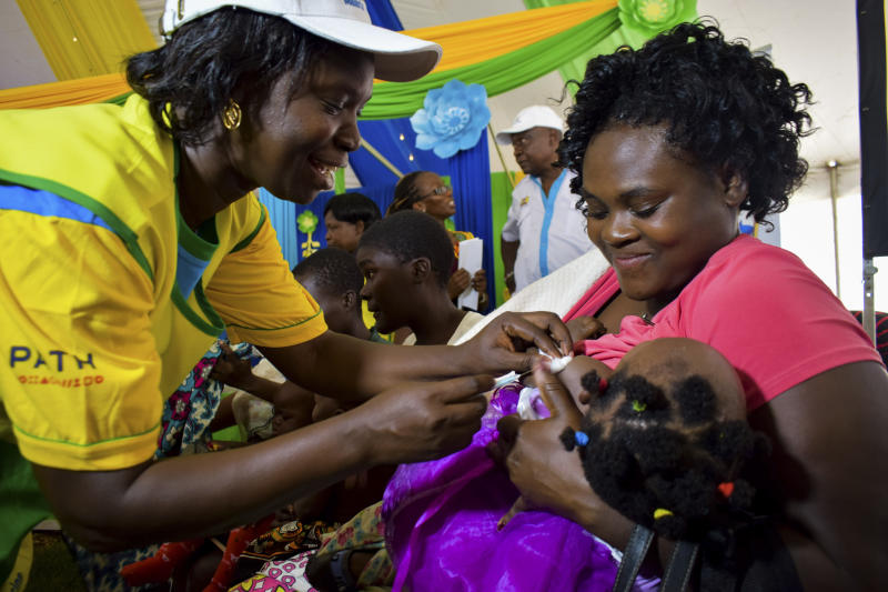 A health worker vaccinates a child against malaria in Homabay County, western Kenya, Friday Sept.13, 2019. The vaccine is the world's first for malaria and has been rolled out in Kenya, Ghana, and Malawi by the World Health Organisation. (AP Photo/Joseph Oduor)