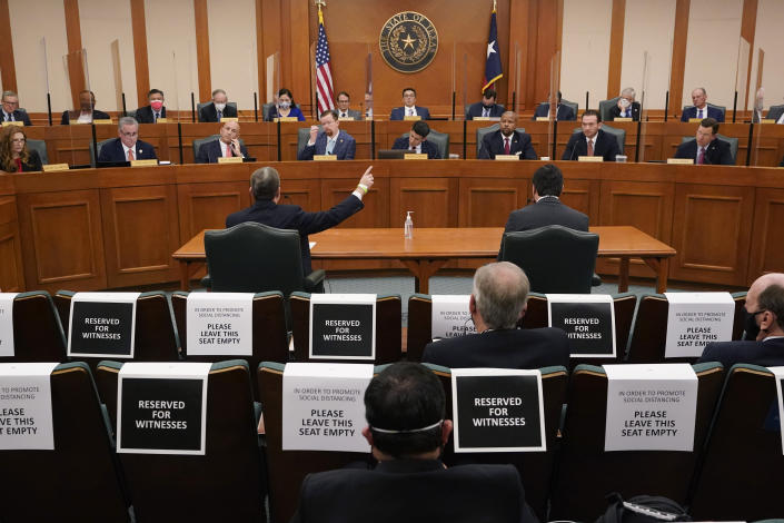 ADDS NAME Curtis Morgan, the CEO of Vistra Corp., at table left, testifies as the Committees on State Affairs and Energy Resources holds a joint public hearing to consider the factors that led to statewide electrical blackouts, Thursday, Feb. 25, 2021, in Austin, Texas. The hearings were the first in Texas since a blackout that was one of the worst in U.S. history, leaving more than 4 million customers without power and heat in subfreezing temperatures. (AP Photo/Eric Gay)