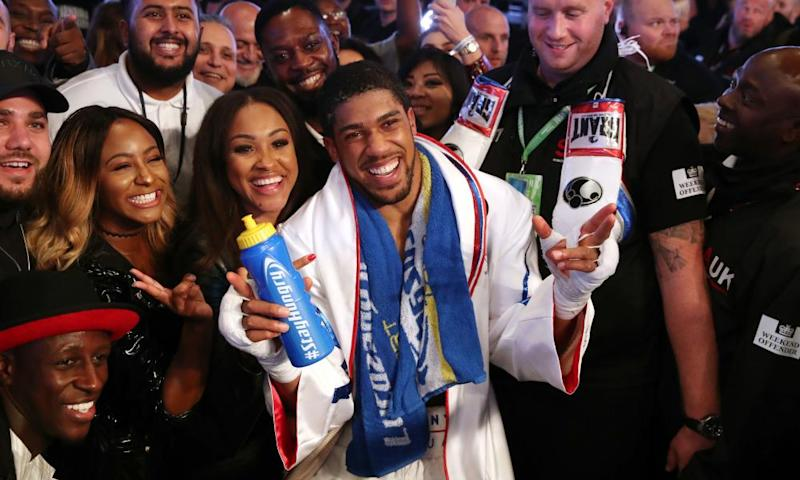 Anthony Joshua celebrates with spectators at Wembley after beating Alexander Povetkin