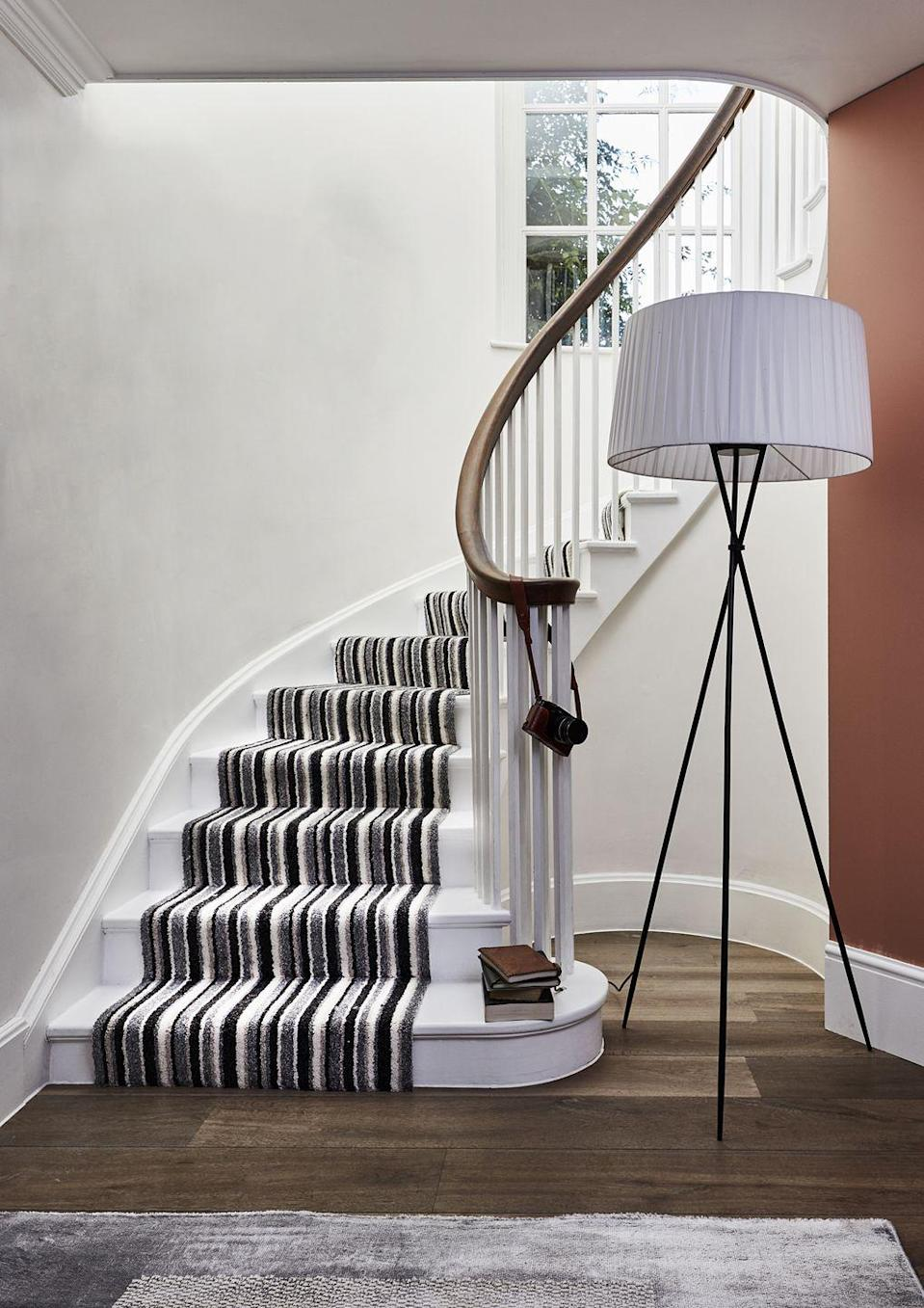 """<p>As well as drawing attention, striped carpets help create the illusion of a bigger space, which is great for a smaller <a href=""""https://www.housebeautiful.com/uk/decorate/a36379892/interior-tweaks-happy-home/"""" rel=""""nofollow noopener"""" target=""""_blank"""" data-ylk=""""slk:home"""" class=""""link rapid-noclick-resp"""">home</a>. </p><p>'Often the first thing you see when entering a house, the stairs and hallway create a first and lasting impression on your guests,' says Jemma Dayman, Buyer, Carpets and Rugs at Carpetright. 'It's the perfect area to take risks and be daring with your styling.'</p><p>Pictured: <a href=""""https://www.carpetright.co.uk/carpets/boston-stripes-pattern-carpet/"""" rel=""""nofollow noopener"""" target=""""_blank"""" data-ylk=""""slk:'Boston Stripes' by Carpetright"""" class=""""link rapid-noclick-resp"""">'Boston Stripes' by Carpetright</a></p>"""