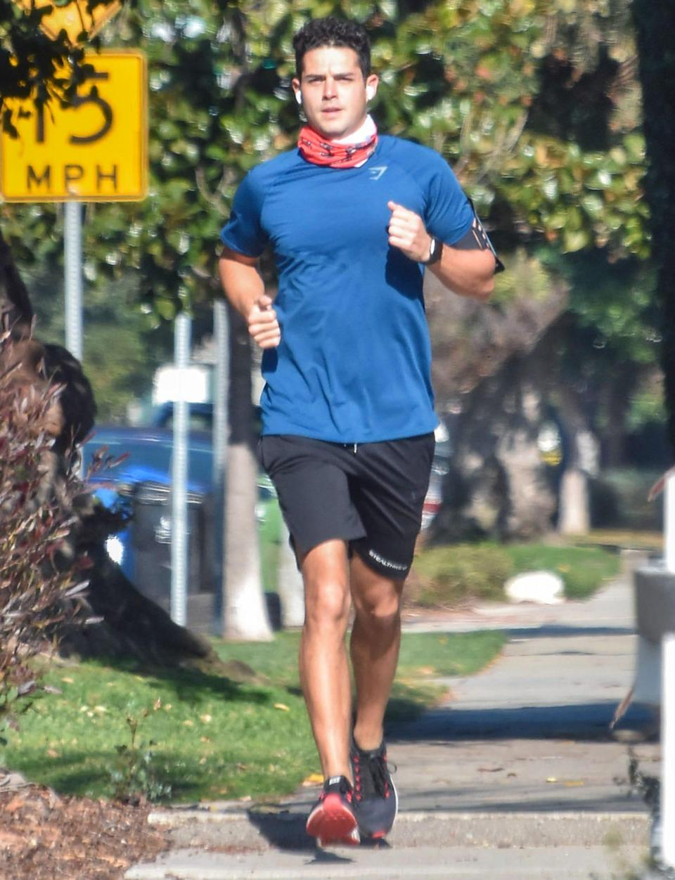 <p>Wells Adams goes for a jog, wearing a blue tee, shorts and sneakers, on Monday in L.A.</p>