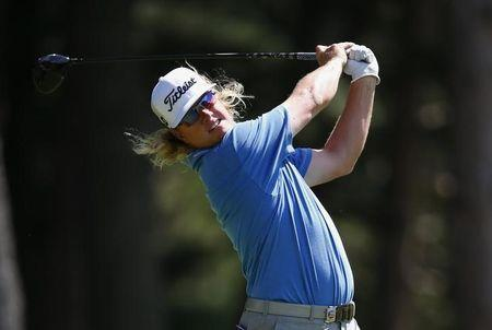 Charley Hoffman of the U.S. tees off on the fourth hole during the third round of the 2013 PGA Championship golf tournament at Oak Hill Country Club in Rochester, New York August 10, 2013. REUTERS/Jeff Haynes