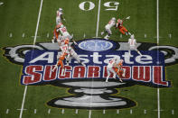 Ohio State quarterback Justin Fields passes against Clemson during the first half of the Sugar Bowl NCAA college football game Friday, Jan. 1, 2021, in New Orleans. (AP Photo/Butch Dill)