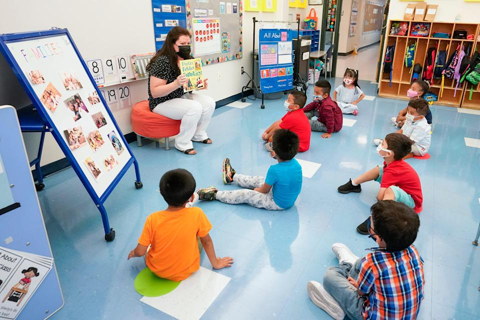 In this Sept. 16, 2021, file photo Pre-K teacher Vera Csizmadia teaches 3-and 4-year-old students in her classroom at the Dr. Charles Smith Early Childhood Center in Palisades Park, N.J.