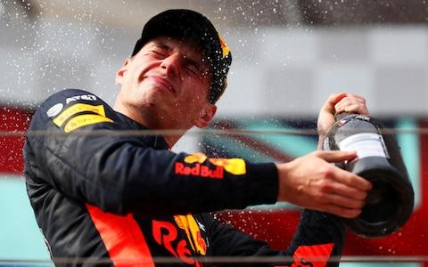 Second place finisher Max Verstappen of Netherlands and Red Bull Racing celebrates on the podium during the Formula One Grand Prix of France at Circuit Paul Ricard on June 24, 2018 in Le Castellet - Credit: GETTY IMAGES