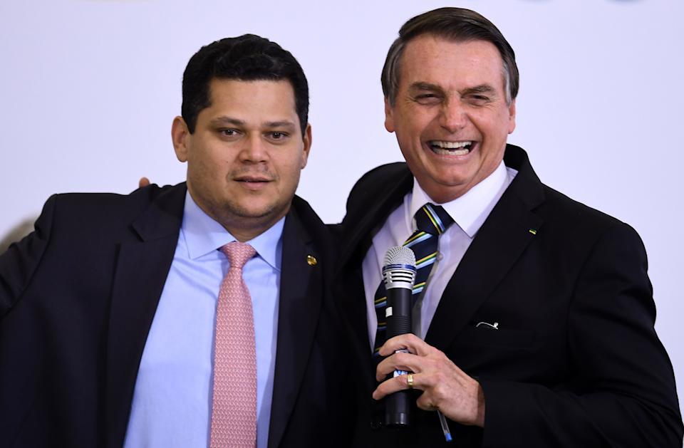 Brazilian President Jair Bolsonaro (R) and the president of the Brazilian Senate Davi Alcolumbre, attend a ceremony to commemorate the first 200 days of Bolsonaro's administration at Planalto Palace in Brasilia, on July 18, 2019. - Bolsonaro signed a membership application for the Organisation for Economic Co-operation and Development (OECD) during the ceremony. (Photo by EVARISTO SA / AFP)        (Photo credit should read EVARISTO SA/AFP/Getty Images)