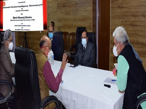 LG Manoj Sinha in conversation with other officials during the launch on Friday. [Photo: @manojsinha_/Twitter]