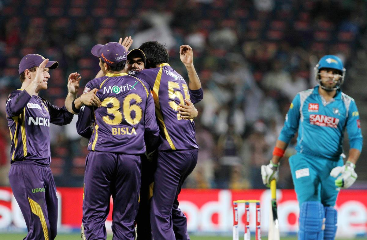 Kolkata Knight Riders players celebrates after getting the Pune Warriors player Yuvraj Singh during match 56 of the Pepsi Indian Premier League ( IPL) 2013  between The Pune Warriors India and the Kolkata Knight Riders held at the Subrata Roy Sahara Stadium, Pune on the 9th May 2013. (BCCI)