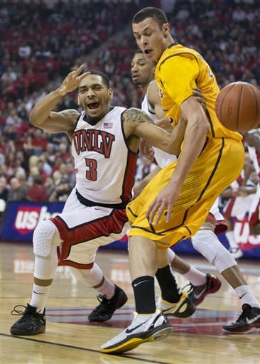 UNLV's Anthony Marshall is fouled as he is stripped of the ball by Wyoming's Larry Nance Jr. in the first half of an NCAA college basketball game on Thursday, Jan. 24, 2013, in Las Vegas. (AP Photo/Julie Jacobson)