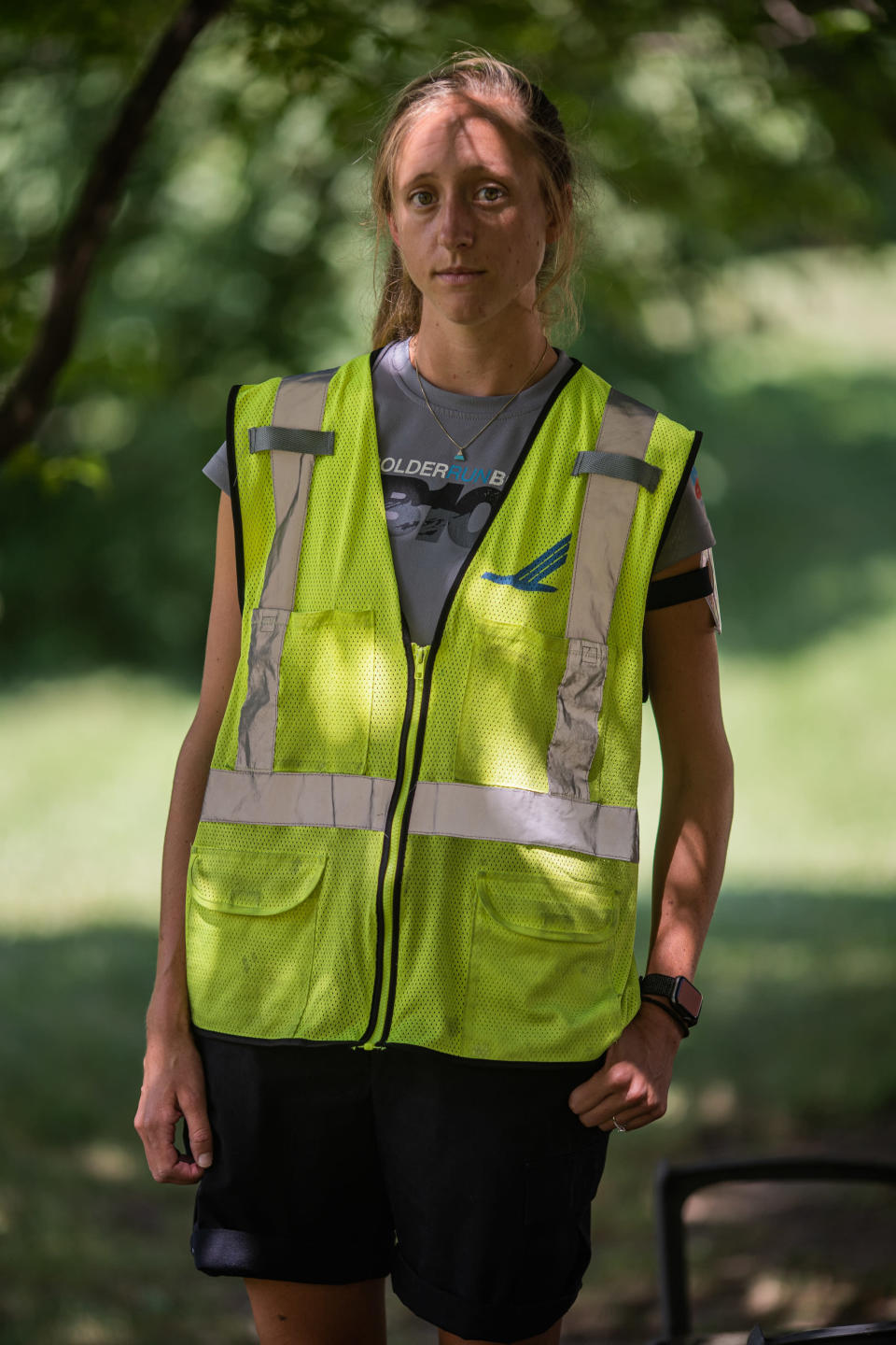 Annie Frodeman, who cobbled together work shifts registering emergency patients at a hospital, and as an airport ramp agent, in her airport safety vest near her home outside Burlington, Vt., July 21, 2020. (John Tully/The New York Times)