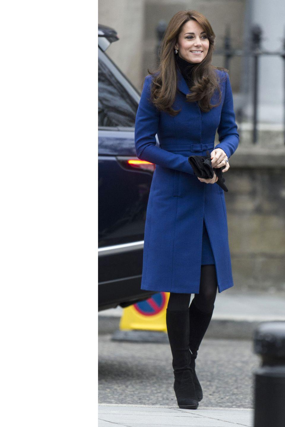 <p>In this turtleneck-layered look, the Duchess wore a royal blue Christopher Kane coat and black suede knee-high boots on her trip to Dundee, Scotland. </p>