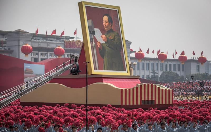 A float carrying a portrait of late Chinese leader and founder of the People's Republic of China, chairman Mao Zedong - REX