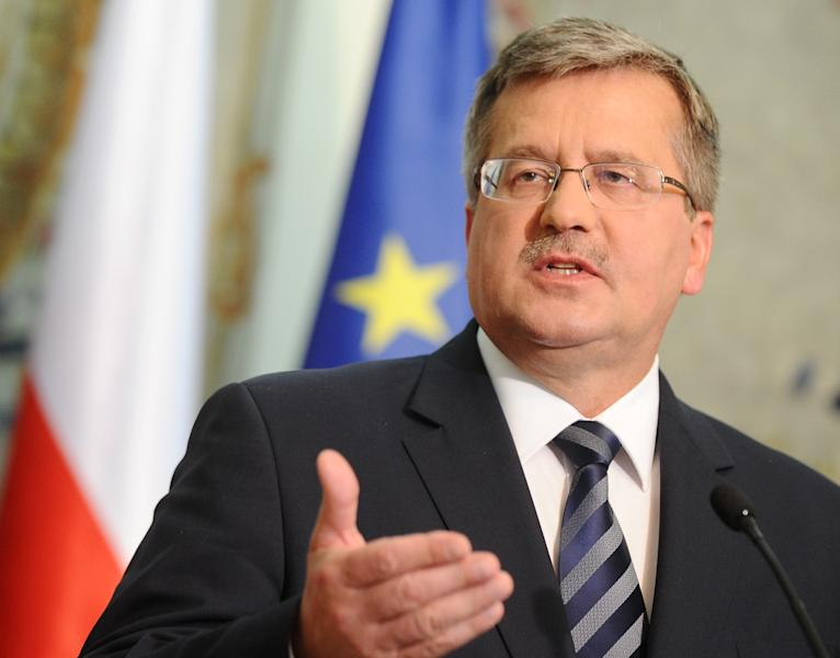 "Polish President Bronislaw Komorowski gestures during a press conference as he informs about U.S. President's Barack Obama letter, in Warsaw, Poland, Friday, June 1, 2012. Obama has written a letter to Komorowski expressing ""regret"" for an inadvertent verbal gaffe that caused a storm controversy in Poland this week, after the U.S. President used the expression ""Polish death camp"" , rather than ""Nazi death camp in German occupied Poland, while honoring a Polish WW II hero. (AP Photo/Alik Keplicz)"