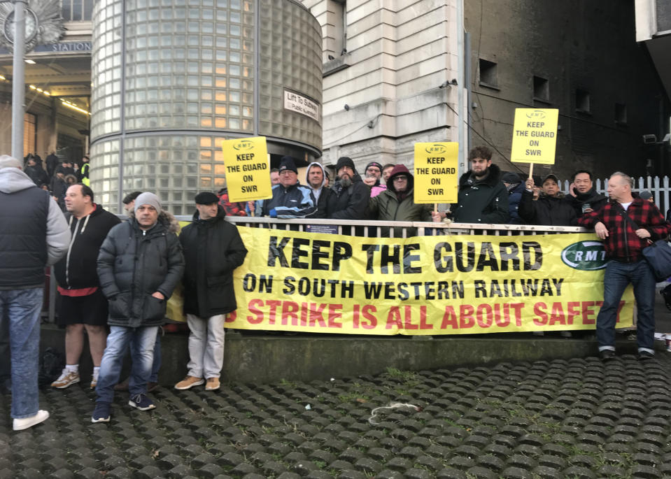BEST QUALITY AVAILABLE People protesting outside Waterloo station, as hundreds of thousands of rail passengers faced travel misery on Monday at the start of a series of strikes in the long-running dispute over guards on trains.