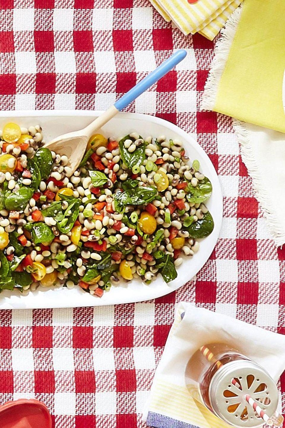"""<p>Get plenty of fiber with a crunchy salad filled with fresh vegetables.</p><p><strong><a href=""""https://www.countryliving.com/food-drinks/recipes/a42429/fresh-black-eyed-peas-salad-recipe/"""" rel=""""nofollow noopener"""" target=""""_blank"""" data-ylk=""""slk:Get the recipe"""" class=""""link rapid-noclick-resp"""">Get the recipe</a>.</strong></p><p><a class=""""link rapid-noclick-resp"""" href=""""https://www.amazon.com/Redecker-Oiled-Olive-Serving-8-Inches/dp/B01MCTSZJJ/?tag=syn-yahoo-20&ascsubtag=%5Bartid%7C10050.g.3290%5Bsrc%7Cyahoo-us"""" rel=""""nofollow noopener"""" target=""""_blank"""" data-ylk=""""slk:SHOP SERVING SPOONS"""">SHOP SERVING SPOONS</a> </p>"""