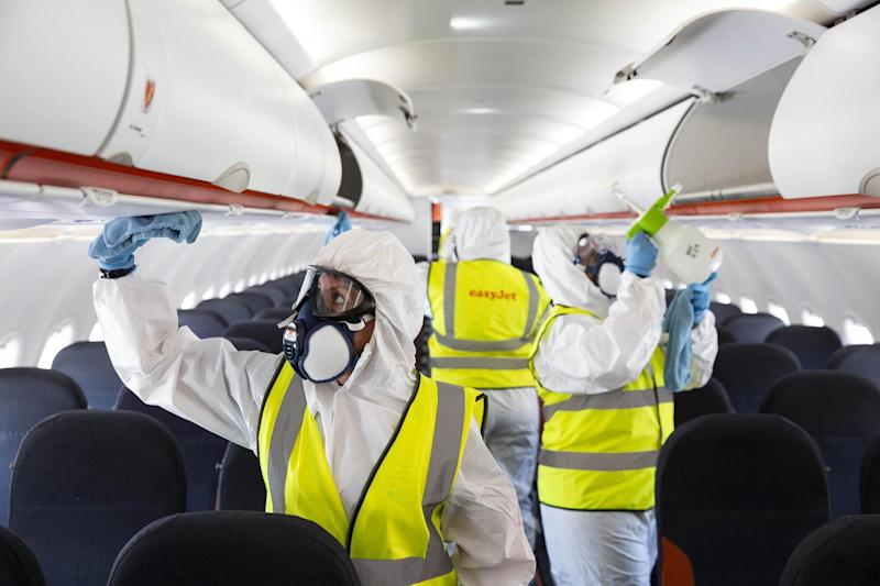 A file picture of staff cleaning an EasyJet plane at Gatwick Airport: PA