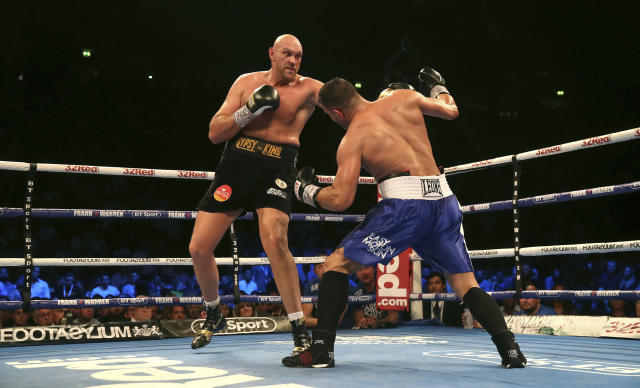Britain's Tyson Fury, left, punches Sefer Seferi during their heavyweight bout at the Manchester Arena, in Manchester, England, Saturday June 9, 2018. (Nick Potts/ PA via AP)