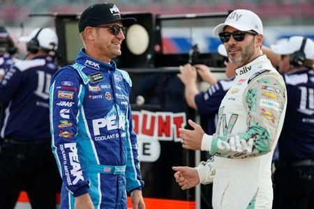 May 23, 2019; Concord, NC, USA; Monster Energy NASCAR Cup Series driver Clint Bowyer (14) talks with driver Jimmie Johnson (48) during qualifying for the Coca-Cola 600 at Charlotte Motor Speedway. Mandatory Credit: Jim Dedmon-USA TODAY Sports