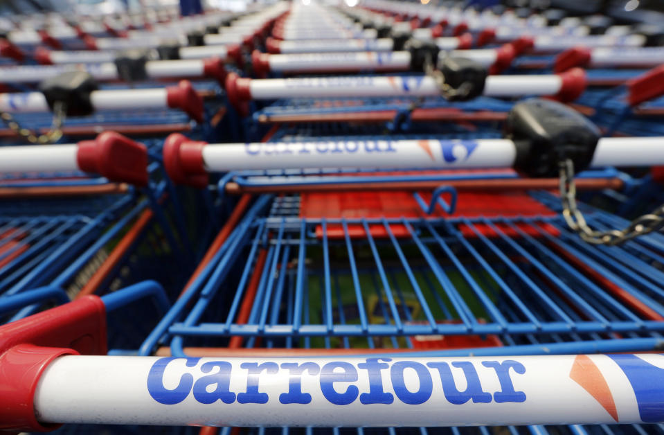 Shopping trolleys line up at the entrance of the Carrefour hypermarket in Brive-La-Gaillarde, central France, July 8, 2013. France is the biggest country in Europe for hypermarkets and the store's growth mirrors Carrefour's past global expansion. But that growth masks the gradual decline of the format. The hypermarket - an out-of-town warehouse of more than 2,500 square metres which offers everything from camembert cheese to lawn mowers - is shrinking as online vendors, convenience shops and discounters meet many of the needs of a cash-strapped, increasingly fragmented population. Picture taken July 8, 2013. REUTERS/Regis Duvignau (FRANCE - Tags: BUSINESS LOGO)