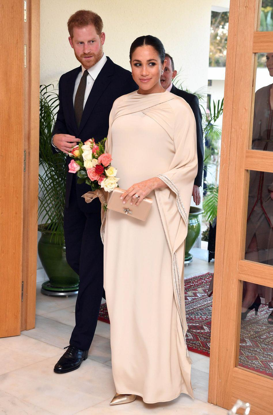 <p>Meghan Markle wore an elegant cream draped gown on the second day of her royal tour in Morocco. The Duchess wore the Dior gown for a reception held at the British Residence in Rabat, Morocco. </p>