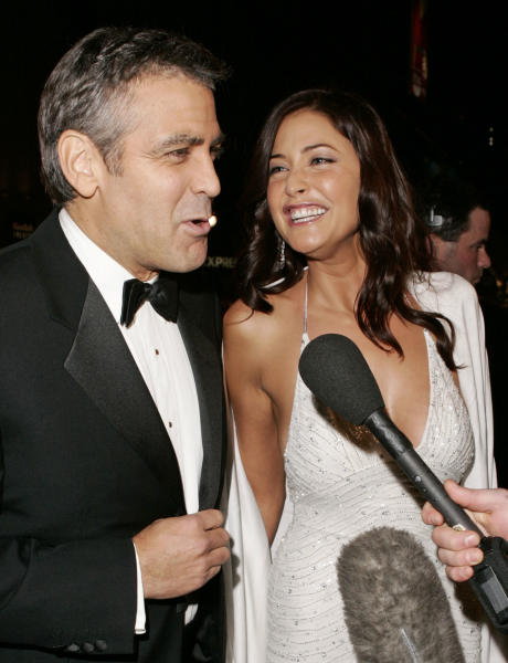 """FILE - In this Dec. 8, 2004 file photo, cast member George Clooney, left, speaks to the media with British actress Lisa Snowdon as they arrive for the premiere of """"Ocean's Twelve,"""" at the Grauman's Chinese Theatre in the Hollywood section, of Los Angeles. Clooney, 52, Hollywood's most determined bachelor, famous for a litany of fleeting loves, including Snowdon, has taken himself off the romantic market and proposed to 36-year-old attorney Amal Alamuddin. A spokesman for the Oscar-winning actor and producer did not respond to requests for comment Monday, April 28, 2014. (AP Photo/Kevork Djansezian, file)"""
