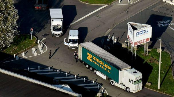 PHOTO: An aerial view shows French police officers searching a truck on Oct. 14, 2017, in Calais, France. (Francois Lo Presti/AFP via Getty Images, FILE)