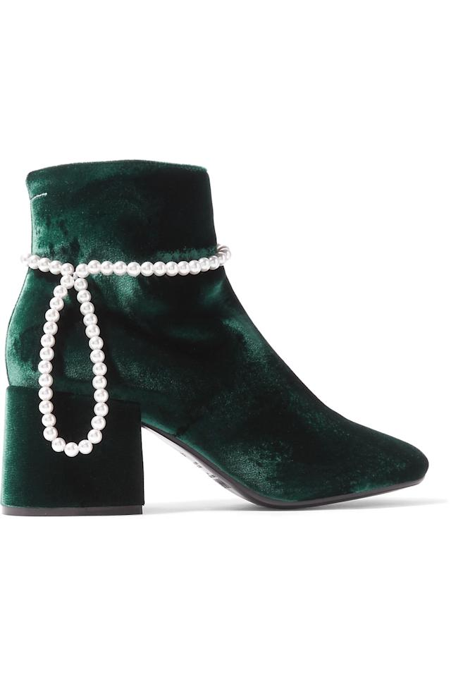 "<p>Velvet? Tick. Pearls? Tick. What more could you possibly want from a pair of boots this winter? We'll be wearing ours with a metallic slip dress this party season.<br /><br /><em><a rel=""nofollow"" href=""https://www.net-a-porter.com/gb/en/product/915542/MM6_Maison_Margiela/faux-pearl-embellished-velvet-ankle-boots"">Maison Margiela</a>, £540</em> </p>"