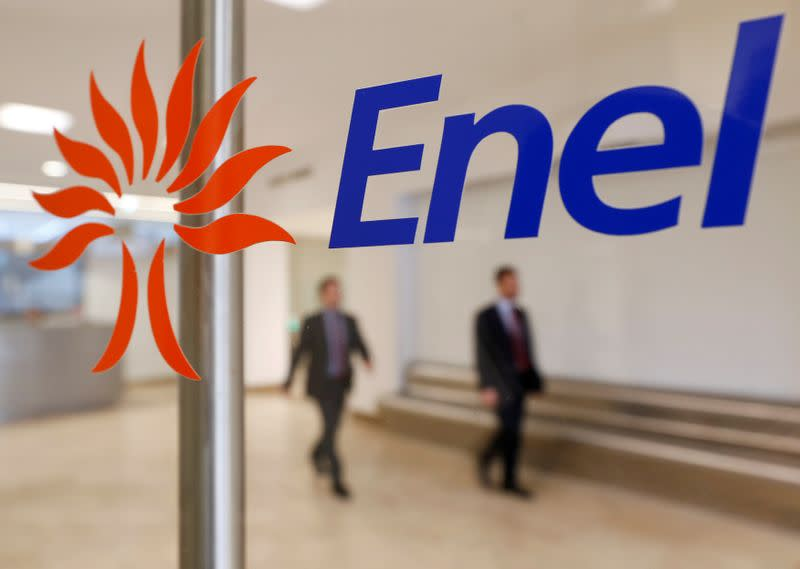 FILE PHOTO: People walk past the logo of Italy's biggest utility Enel at their Rome headquarters
