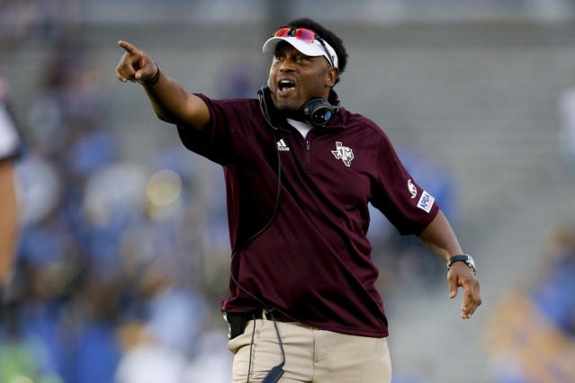 Texas A&M head coach Kevin Sumlin yells to one of his players during the Aggies' loss to UCLA on Sunday. (AP)