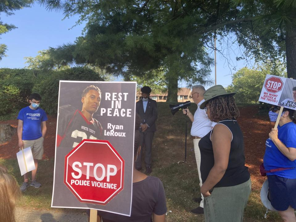 Activists gather for a vigil on Tuesday, July 27, 2021 near the McDonald's restaurant in Gaithersburg, Md. where Ryan LeRoux, a 21-year-old Black man, was shot and killed by police on July 16. (AP Photo/Michael Kunzelman)