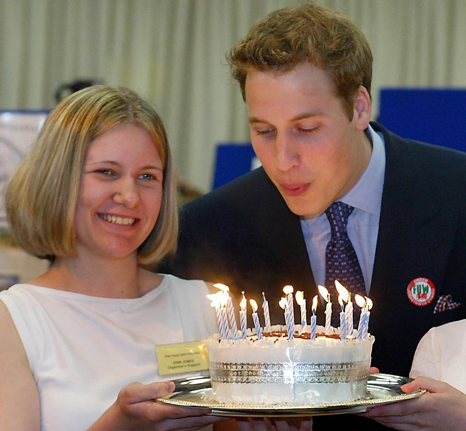 <p>William blowing out the candles on a cake made for him during a visit to Anglesey Food Fair in north Wales in 2003, ahead of his 21st birthday. (Ian Hodgson/AFP via Getty Images)</p>