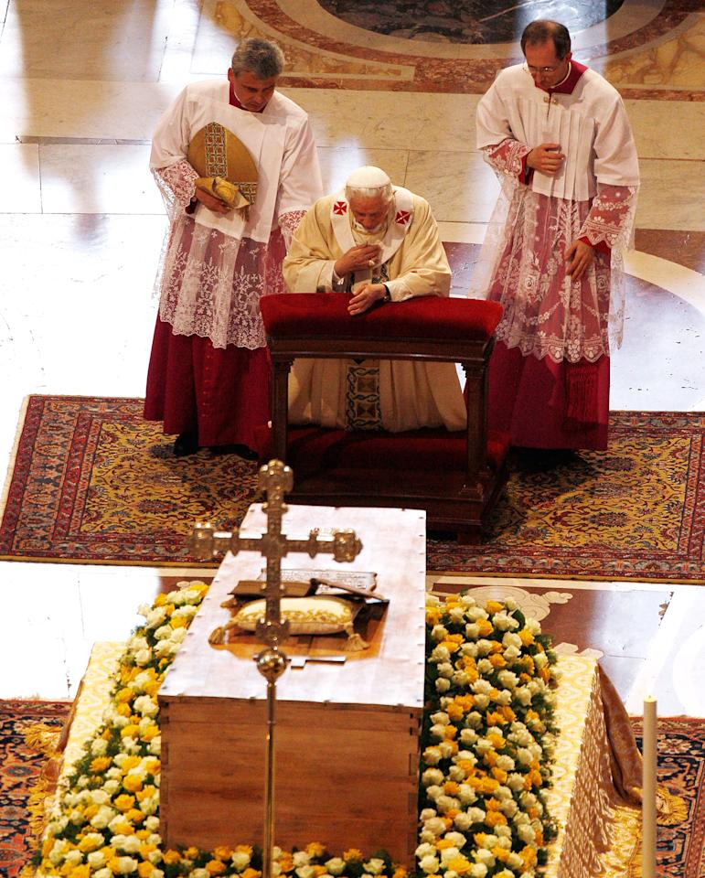 VATICAN CITY, VATICAN - MAY 01:  Pope Benedict XVI prays in front of the coffin of John Paul II at St. Peter's Basilica at the end of John Paul II Beatification Ceremony on May 1, 2011 in Vatican City, Vatican. The ceremony marking the beatification and the last stages of the process to elevate Pope John Paul II to sainthood was led by his successor Pope Benedict XI and attended by tens of thousands of pilgrims alongside heads of state and dignitaries.  (Photo by Pool/Getty Images)