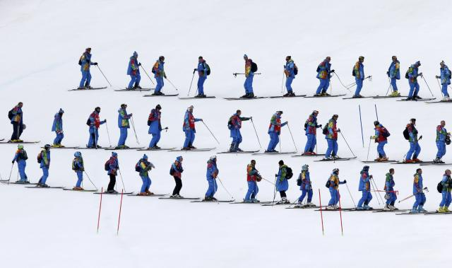 Course slippers prepare the slalom piste ahead of the slalom run of the men's alpine skiing super combined event during the 2014 Sochi Winter Olympics at the Rosa Khutor Alpine Center in Rosa Khutor February 14, 2014. REUTERS/Mike Segar (RUSSIA - Tags: OLYMPICS SPORT SKIING TPX IMAGES OF THE DAY)