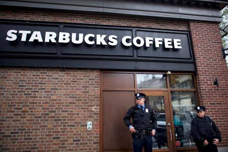 Police officers monitor activity outside as protestors demonstrate inside a Center City Starbucks, where two black men were arrested, in Philadelphia