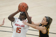 Maryland's Ashley Owusu (15) shoots against Iowa's Gabbie Marshall (24) during the first half of an NCAA college basketball game in the championship of the Big Ten Conference tournament, Saturday, March 13, 2021, in Indianapolis. (AP Photo/Darron Cummings)