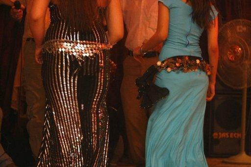 Iraqi women take to the dance floor at a nightclub in central Baghdad