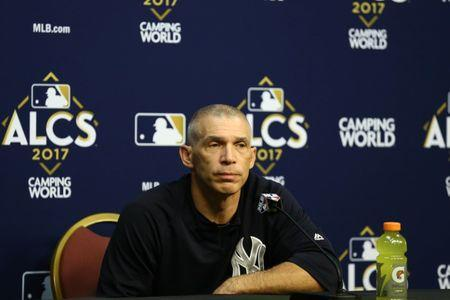 FILE PHOTO: New York Yankees manager Joe Girardi (28) speaks to media before game seven of the 2017 ALCS playoff baseball series against the Houston Astros at Minute Maid Park, Oct 21, 2017; Houston, TX, USA. Mandatory Credit: Troy Taormina-USA TODAY Sports