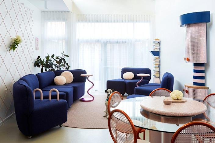 The living area inside Frenches Interiors is cozy, colorful, and centered around a neat modular