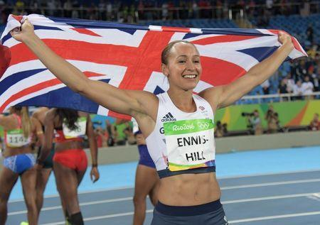 Aug 13, 2016; Rio de Janeiro, Brazil; Jessica Ennis-Hill (GBR) holds up a Great Britain flag after the women's heptathlon 800m event at Estadio Olimpico Joao Havelange during the Rio 2016 Summer Olympic Games. Mandatory Credit: Kirby Lee-USA TODAY Sports