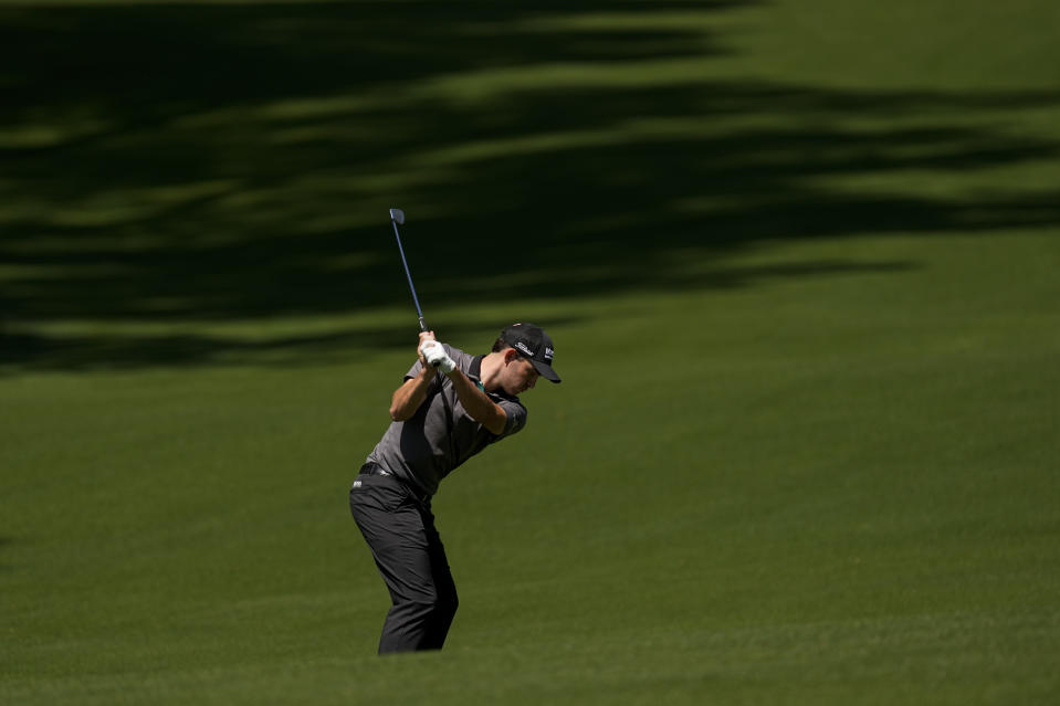 Patrick Cantlay hits from the fairway on the 13th hole during a practice round for the Masters golf tournament on Monday, April 5, 2021, in Augusta, Ga. (AP Photo/Charlie Riedel)