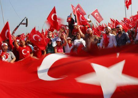 People wave Turkey's national flags during the Democracy and Martyrs Rally in Istanbul