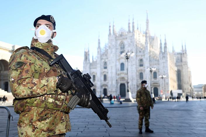 Military officers outside the Duomo cathedral, closed by authorities amid the coronavirus outbreak, in Milan on February 24.
