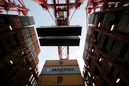 FILE PHOTO: Containers are seen unloaded from the Maersk's Triple-E giant container ship Maersk Majestic, one of the world's largest container ships, at the Yangshan Deep Water Port, part of the  Shanghai Free Trade Zone, in Shanghai