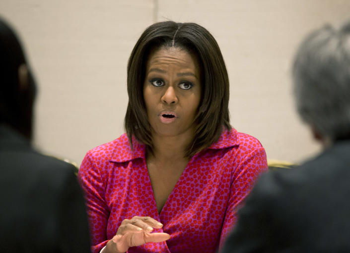 U.S. first lady Michelle Obama speaks during a round table discussion on education at the U.S. Embassy in Beijing, China Sunday, March 23, 2014. (AP Photo/Andy Wong)