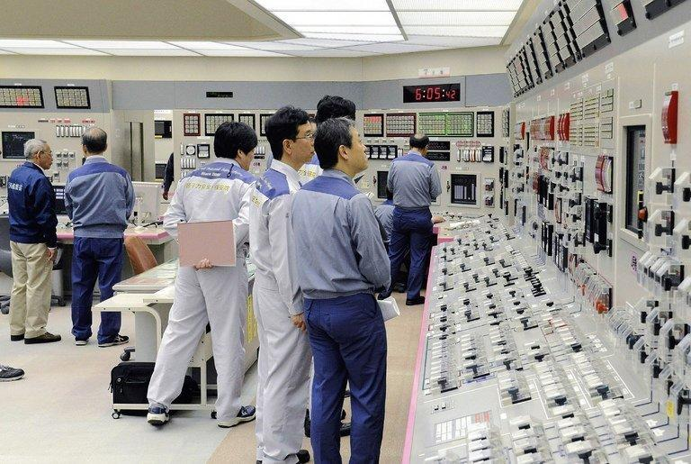 Kansai Electric Power engineers check readings at the Oi nuclear plant in Japan on July 19, 2012. Workers began switching off one of Japan's two working reactors Monday, with the other set for shutdown later this month and no restarts in sight. Kansai Electric Power started reducing generating power at its Unit No. 3 at the Oi plant in the western prefecture of Fukui, a company spokesman said
