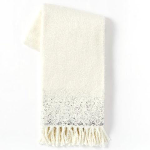 """<p>Nothing's cozier than cuddling up with a good book and a warm blanket, and this soft, knitted throw will do the trick.<span>($20;<a rel=""""nofollow"""" href=""""http://www.westelm.com/products/cozy-texture-throw-t3453/?pkey=cthrows-blankets"""">westelm.com</a>)</span><span></span></p>"""